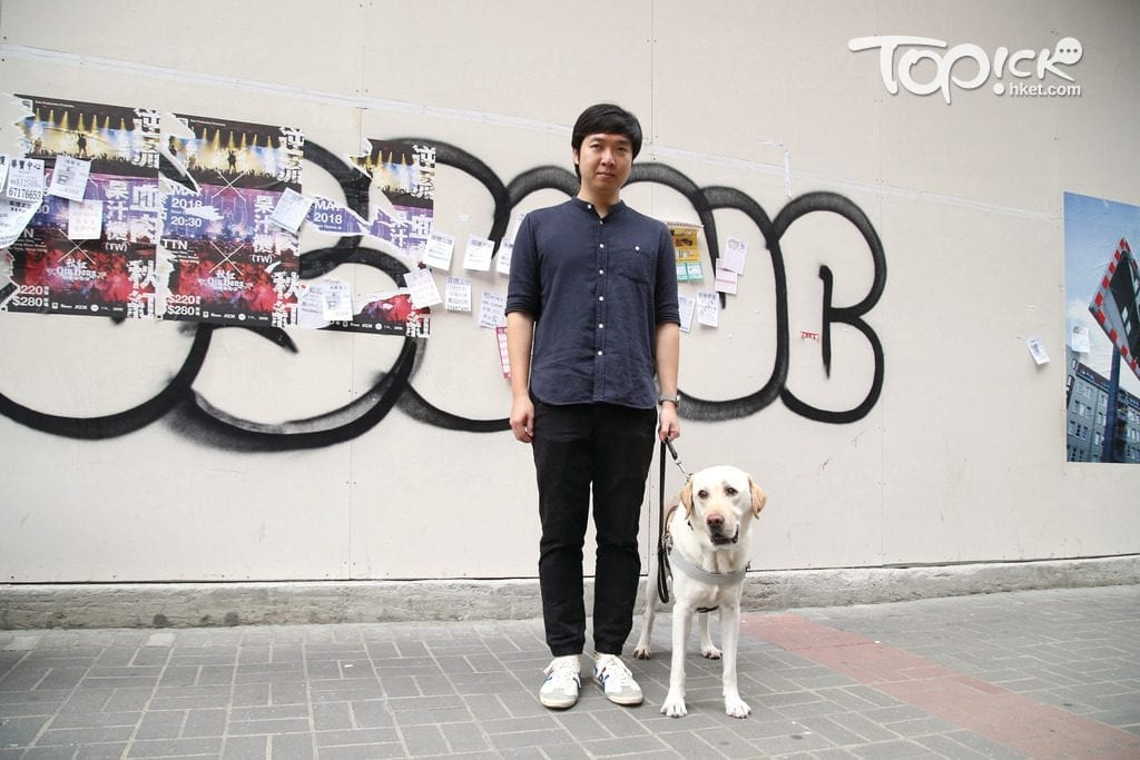 Walter Tsui with guide Dog
